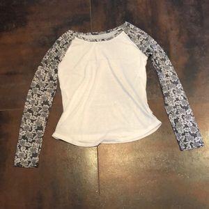 White quarter length sleeved shirt